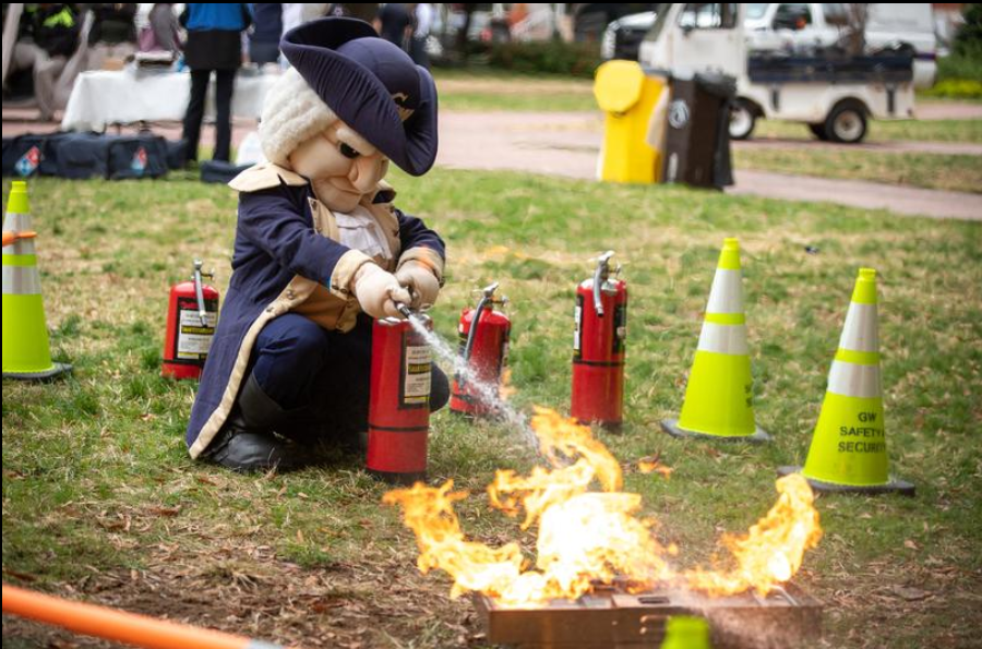 GW Mascot 'George' using a fire extinguisher
